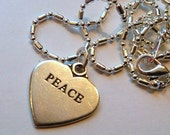 Sterling Silver peace heart pendant charm on a 16 1/2 inch sp chain