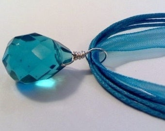 CLOSEOUT SS wired turquoise quartz briolette on a turquoise 18 inch adj. ribbon necklace cord