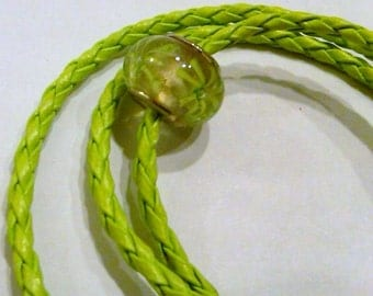 CLOSEOUT Glass bead with green flowers on a green faux leather necklace cord