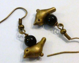 Pair of Antique Brass Bird earrings with a black glass bead