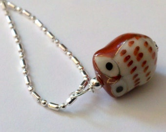 1 Rust Cutesy Porcelain Owl on a sp dot and dash chain