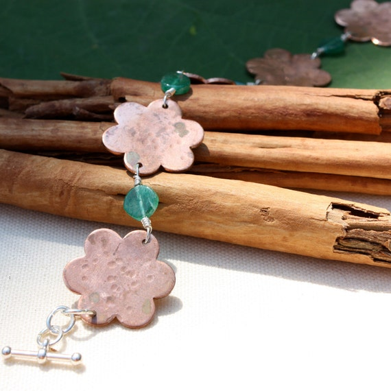 Custom order for Clare. Copper Bracelet Flowers. Sterling Silver with Green beads. Custom stamped names on front flowers, dates on the back.