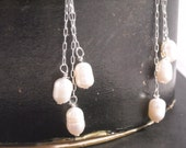 Fresh water pearl earring dangles in sterling silver.  Just marked down.