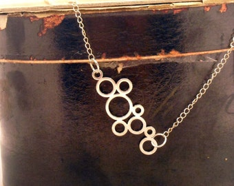 Blowing Bubbles Necklace  in sterling silver