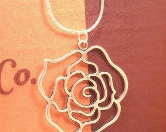 Antiqued Silver Rose necklace.