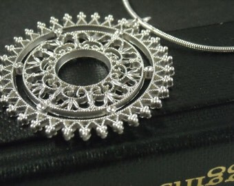 Cathedral lace sterling silver necklace.
