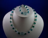 Child's green and crystal flower necklace and bracelet set