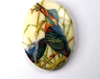 1 pc Oval vintage German plastic bird holding a fish Scene Cabochon 40x30mm