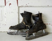 Vintage Black Leather Ice Skates with Timeworn Patina