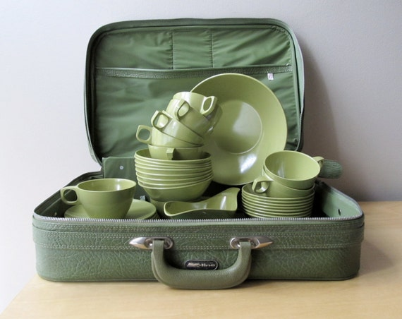 little green suitcase packed with vintage melmac dishes