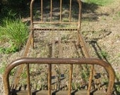 old antique metal twin bed