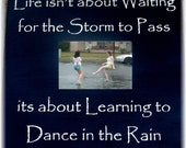 Life isn't about waiting for the storm to pass it's about learning to dance in the rain primitive sign frame