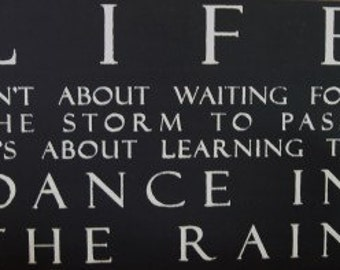 Life Isn't about waiting for the storm to pass it's about Learning to dance in the rain sign