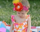 Orange and Yellow Ruffle Ranuculus Flower Rhinestone Bling Center with Yellow Feathers and Shocking Pink Bow on Shocking Pink Lace Headband