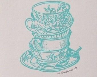 Turquoise  teacup stack letterpress linocut print