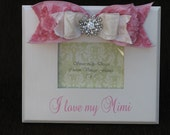 Customized saying white frame with pink and white ribbon with rhinestone embellishment
