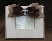 Cream frame with brown glaze with burlap and brown silk ribbon with rhinestone cross embellishment