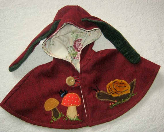 little red cape with snail