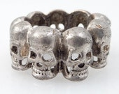 SALE ---- Size 8.5 Vintage Sterling Band of Skulls Ring