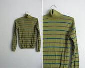 s a l e . vintage '90s OLIVE green STRIPED TURTLENECK. size xs.