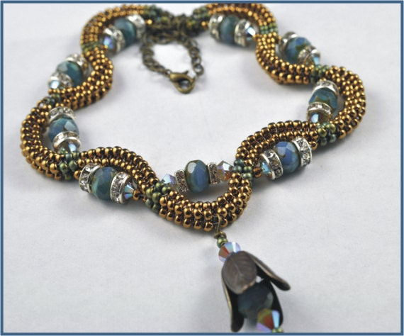 Tubular Herringbone necklace is turquoise and bronze with swarovski crystals
