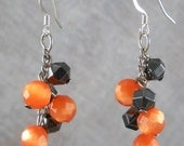 Halloween Orange cats eye and Black Hematite dangle Earrings, halloween earrings, orange and black dangles, holiday earrings