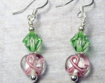 Pink ribbon Earrings with peridot swarovski crystal and silver breast cancer survivors support pink ribbon bead green crystal