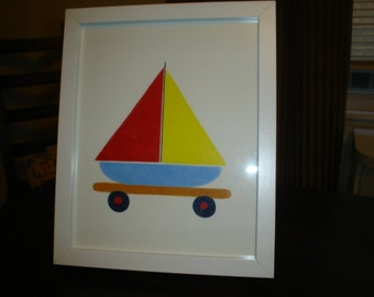 Framed picture/toy sailboat