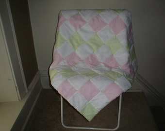 Flannel and chenille quilt/pink and green dots