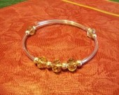 Beautiful Memory Wire Bracelet- Beautiful Champaign Color Faceted Glass Beads