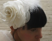 White wedding rose and feather headpiece for a bride made from recycled satin