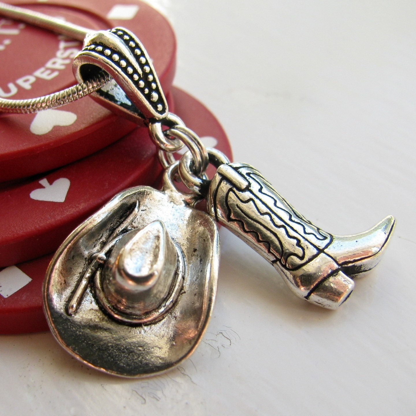 cowboy hat and cowboy boot necklace tierracast antiqued