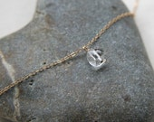 Faceted crystal pendant and gold necklace