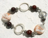 Red spot stone and silver link bracelet