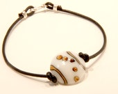 Pebbles lampwork disc and leather bracelet