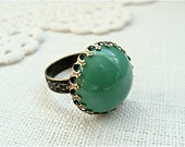 Vintage Swarovski Jade Green Glass Ring.  Antique Brass