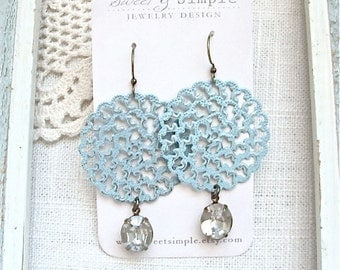 Large pale blue filigree earrings with vintage glass rhinestones.  Big bold shabby chic style.