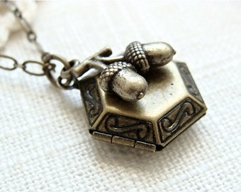 Antique brass acorn locket necklace.  Small hexagon shape with acorn charm.  Jewelry by Sweet And Simple.