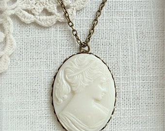 Vintage solid glass cameo pendant necklace.  Antique brass chain, choose your size chain.  Limited stock.