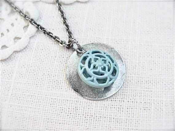 Pastel blue pendant necklace.
