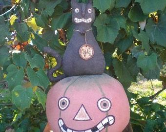 Goblin, The Primitive Scaredy Cat On A Spooky Halloween Pumpkin
