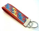 Autism Awareness - Key Fob Wristlet on Red
