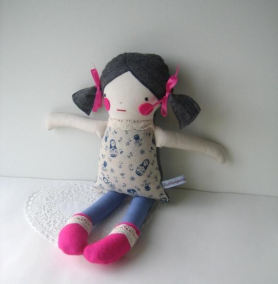 Handmade cloth doll with black/grey hair and Japanese linen body featuring blue matryoshkas