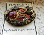 Pook's Gold, Black and Red Wild Fantasy Multi-Colour Glass Cabochon Brooch