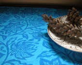 Ultramarine blue passion flower on Pacific blue tea towel
