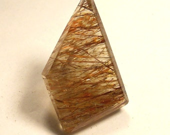 62.5 carat  ......  Faceted Rutilated Quartz Gemstone   ........ 33 X 20 X 16 MM