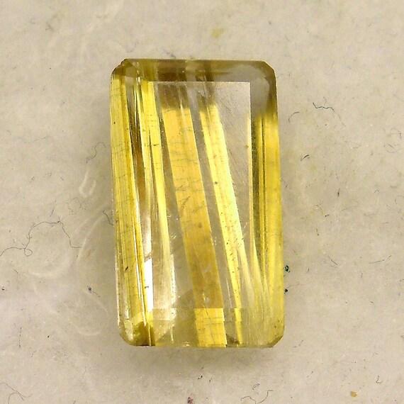 9 carat ... Faceted Rutilated Quartz Gemstone ... 12 x 9 x 6 MM