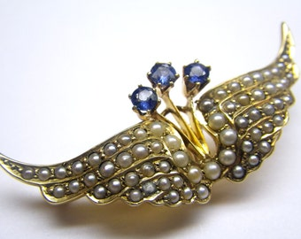 An Exquisite Antique Winged Brooch set with Sapphires and Seed pearls, Circa 1890's. (A910)
