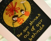 The sun shines out of our behinds 5x7 framed felt