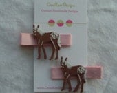 Set of pink\/brown Pony hair clippies